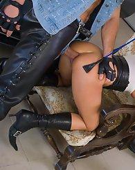 Fetish babe on boots finds two guys and fucks in the garage