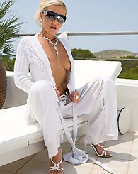 Blond babe in white outfit having outdoor sex on the terrace