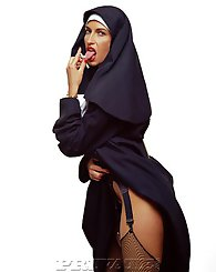 Horny nun shows her holly tits and her ass sitting on chair